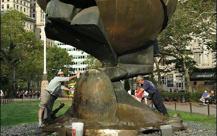 Cleaning the Koenig Sphere Memorial in Battery Park